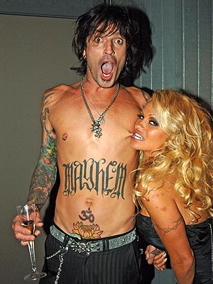 'Pamela Anderson and Tommy Lee Work on the Manuscript of Their Cookbook.